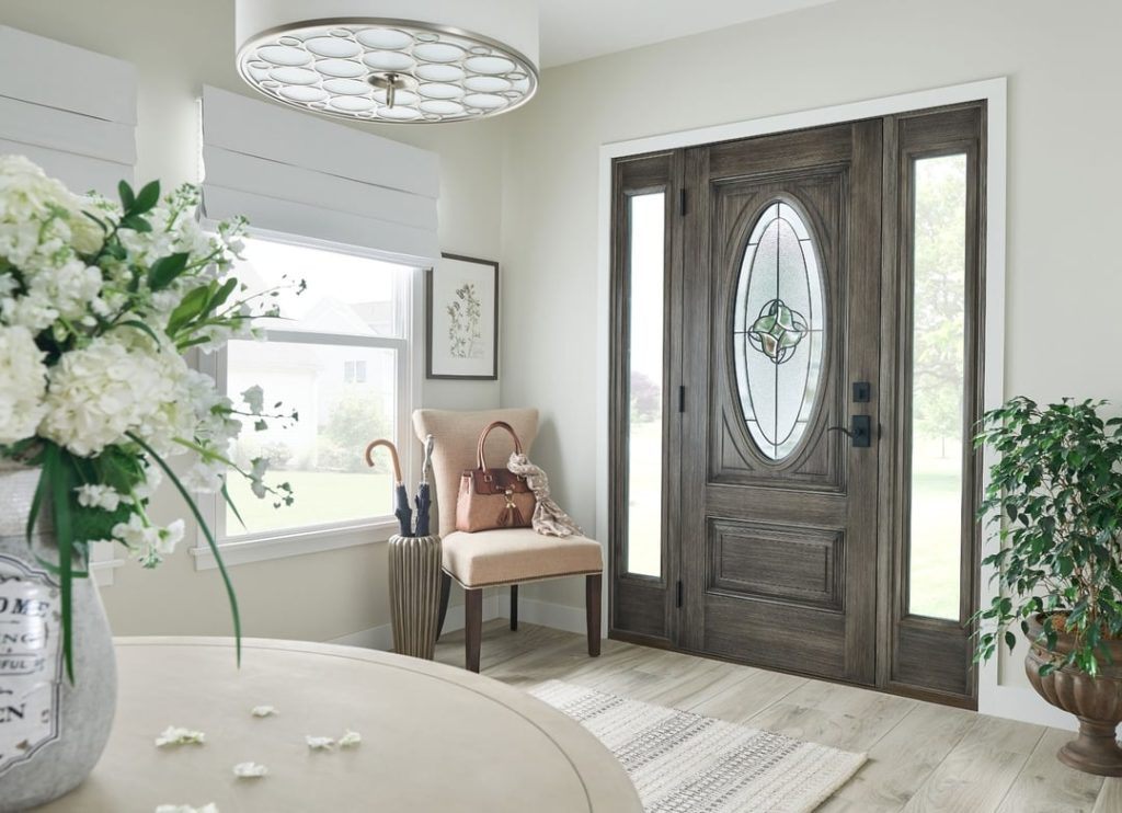 Beautiful entry door and side window with impact glass