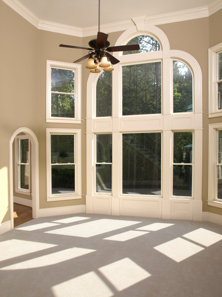Home living room with arched window wall